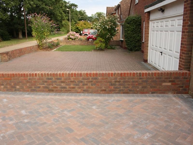 driveway dividing brick wall