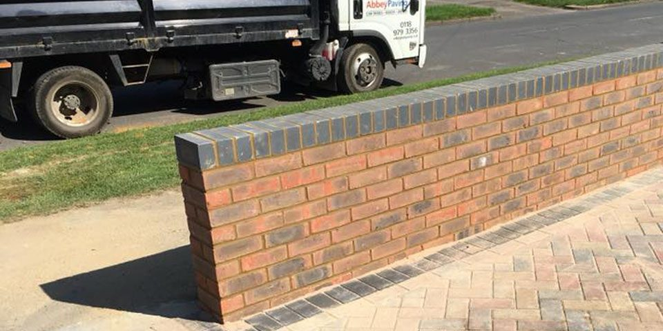 Brick wall by Abbey Paving Team